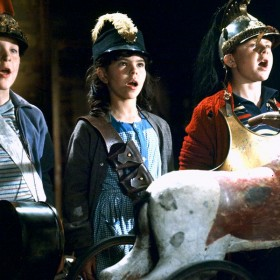 Cast singing with a headless horse