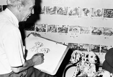 photo of animator Eric Larson sketching live dalmatian puppies