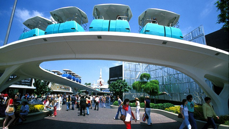 photo of row of PeopleMover cars on curving overhead track at Disneyland