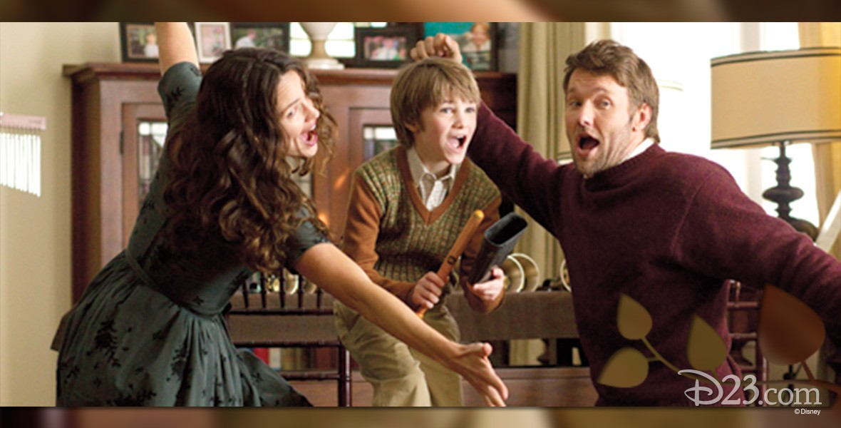 still from movie The Odd Life of Timothy Green showing family singing together