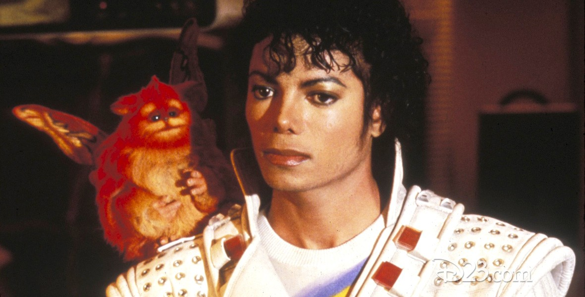 photo of Michael Jackson in costume as Captain EO with small pet monkey on one shoulder