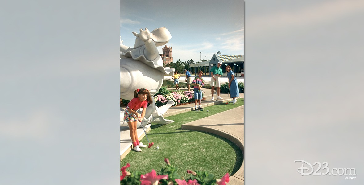 photo of family of four on putt-putt greens of Fantasia Gardens Miniature Golf and Garden Pavilion