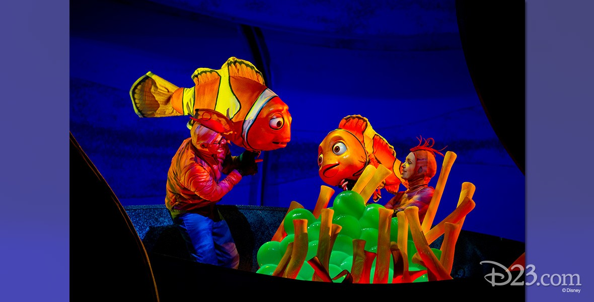 stage production photo of brightly costumed characters in Finding Nemo—the Musical