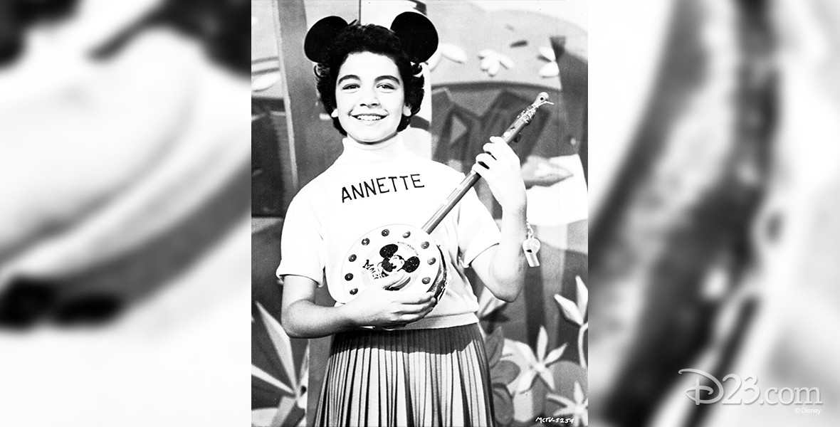 photo of young Annette Funicello wearing Mouseketeer cap and holding a banjo