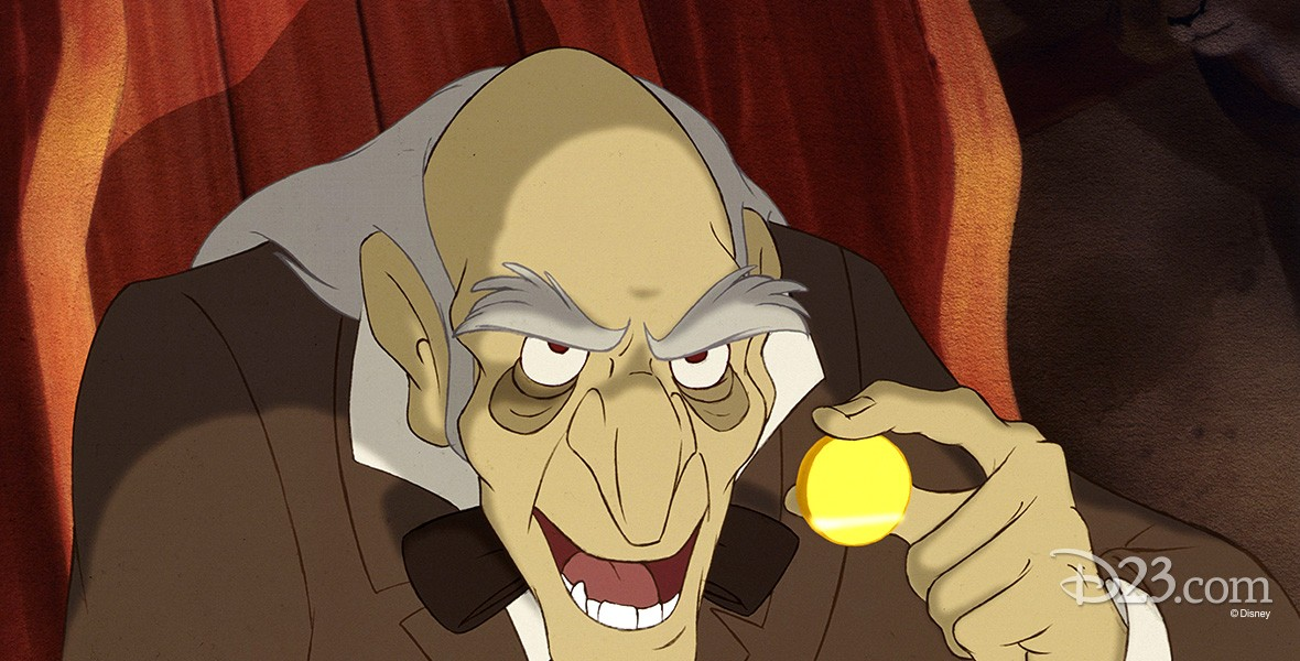 still from Beauty and the Beast showing Monsieur D'Arque looking menacing