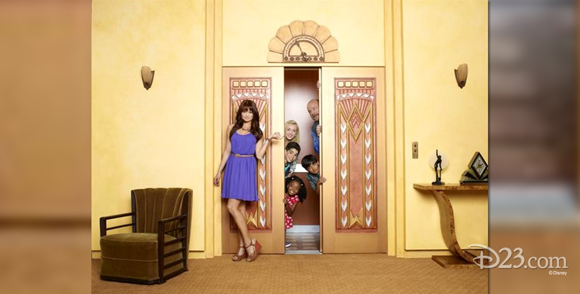 photo of cast of Jessie standing in front of and within old fashioned elevator