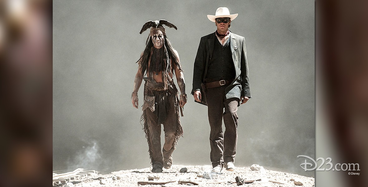 movie still of the Lone Ranger and Tonto walking side-by-side in The Lone Ranger