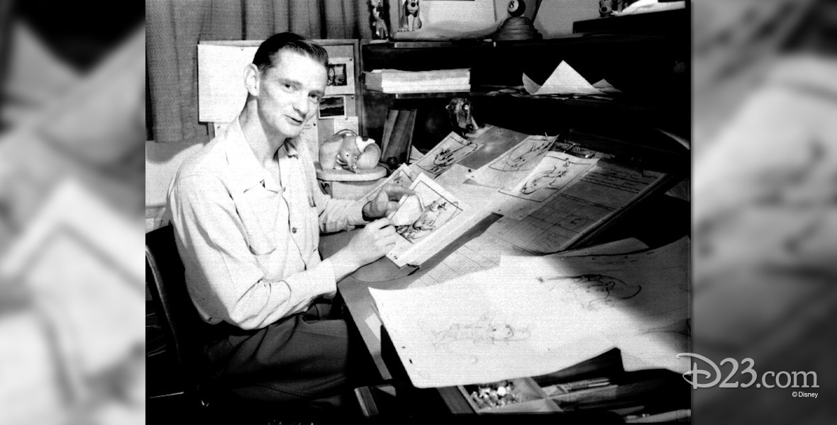 photo of John Lounsbery at his drawing table