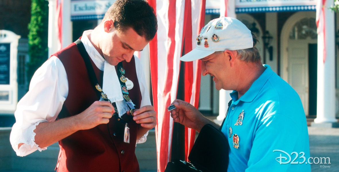 Photo of two men pin trading at Disneyland