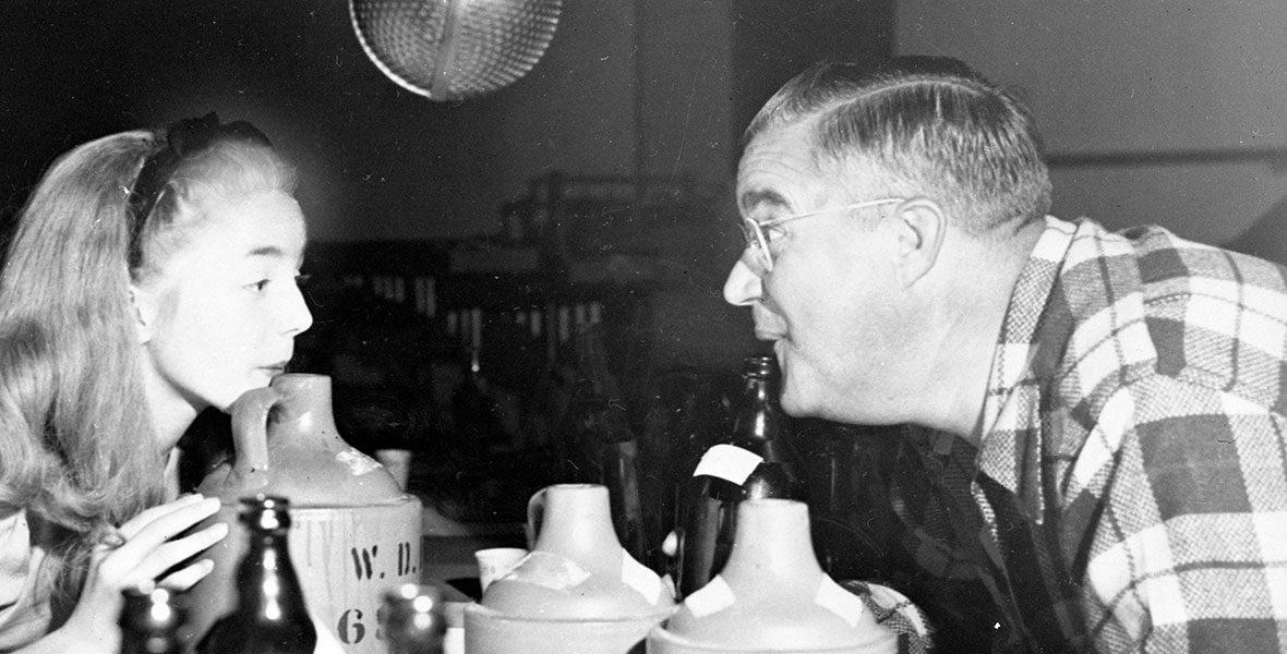 Jimmy Macdonald blowing on a jug