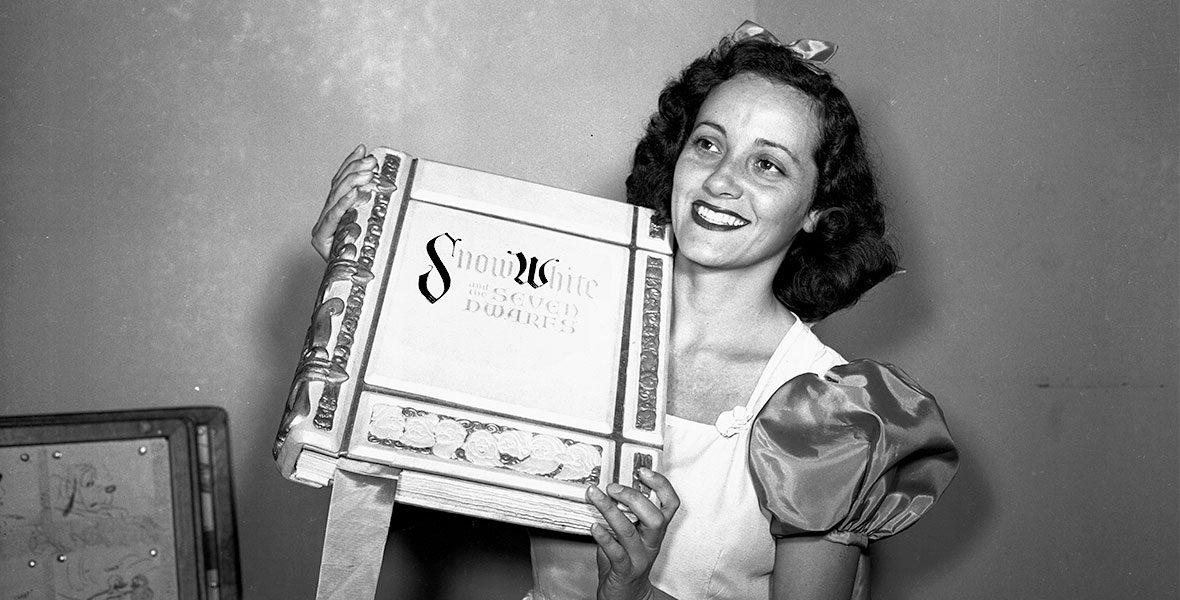 Adriana Caselotti holding Snow White book