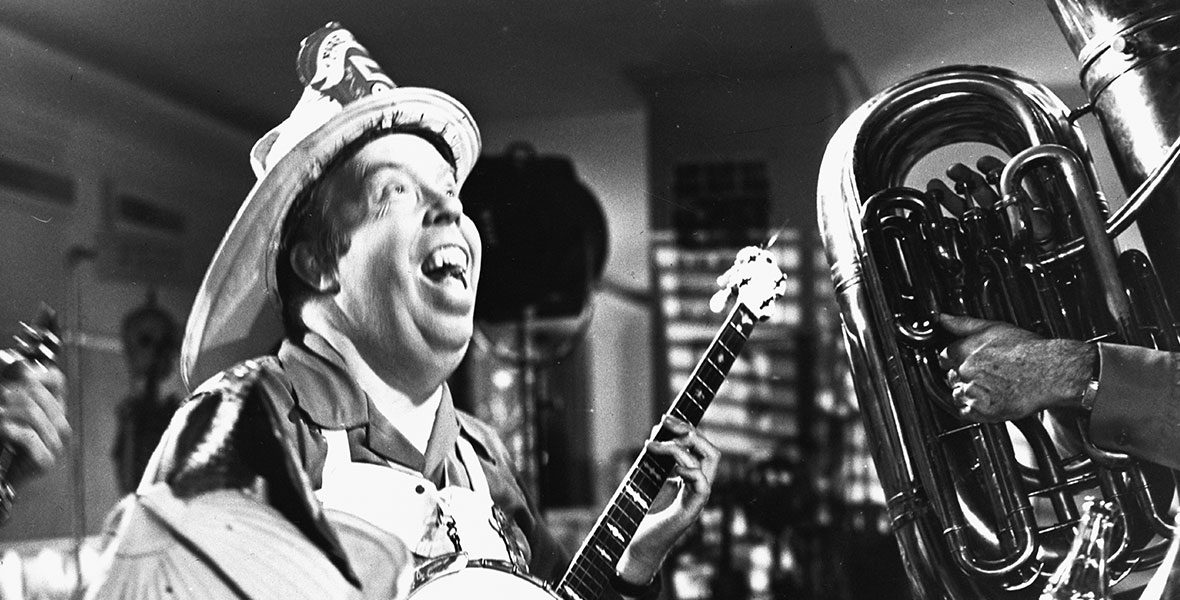 Harper Goff playing banjo