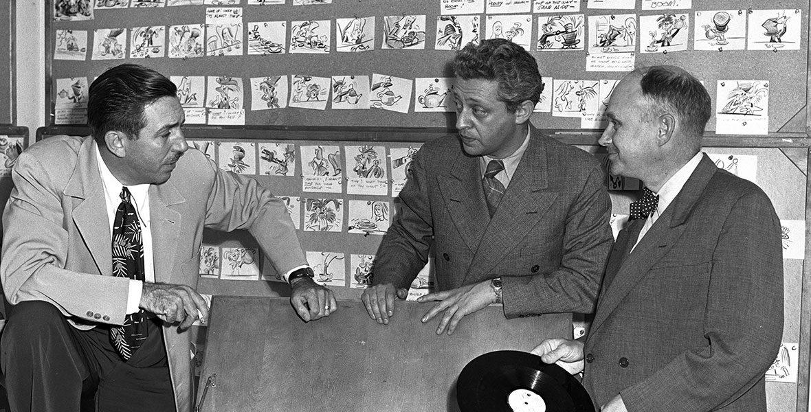 Joe Grant with Walt Disney