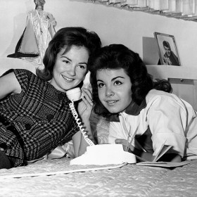 photo of Annette Funicello sharing a telephone call with a friend