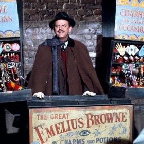 movie still of Davd Tomlinson hawking potions and charms in Bedknobs and Broomsticks