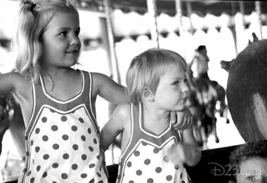 photo of two of Walt Disney's young daughters enjoying Griffith Park carousel