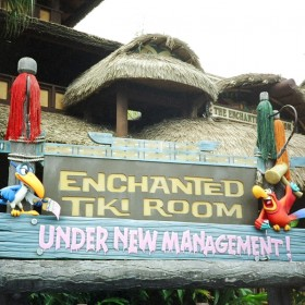 photo of sign outside the enchanted tiki room stating under new management