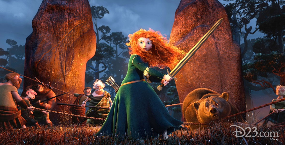still from animated feature Brave showing Merida wielding a sword before a campfire surrounded by friends and a large bear