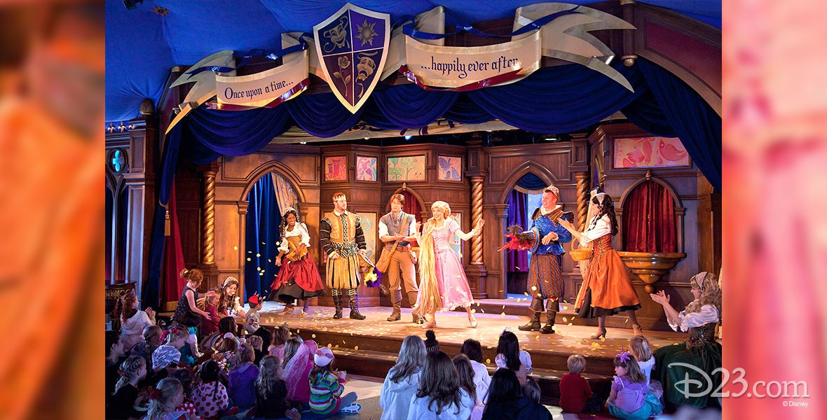 photo of stage production with ensemble medieval characters at Fantasy Faire at Disneyland