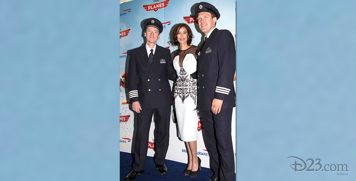 photo of actress Hatcher, Teri flanked by two male cast members from the movie Planes