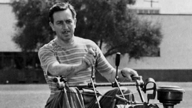 Walt Disney on a lawn mower