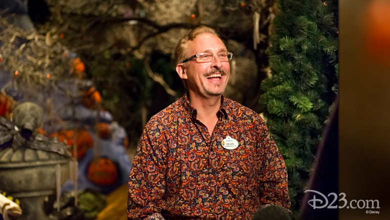 photo of Haunted Mansion Holiday Art Director Brian Sandahl amid his holiday decorations for the attraction