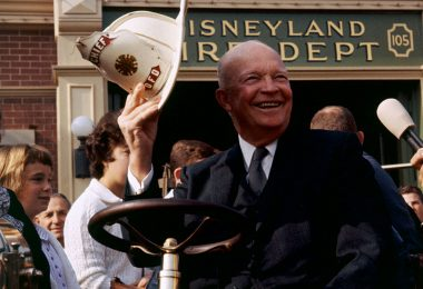 photo of President Eisenhower at wheel of fire engine at Disneyland