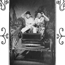 staged portrait of Walt Disney and Ward Kimball posing in a mocked-up old time jalopy during their visit to the1948 Chicago's Museum of Science and Industry