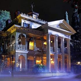 night photo of Haunted Mansion at Disneyland with purple fog