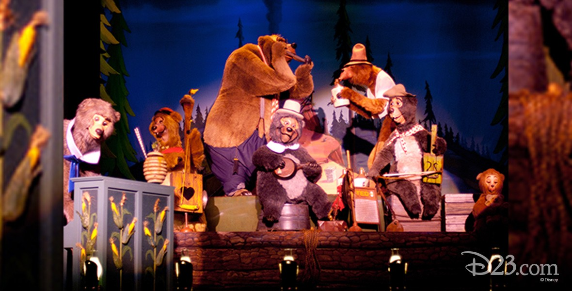 photo of musician bears on stage playing their instruments