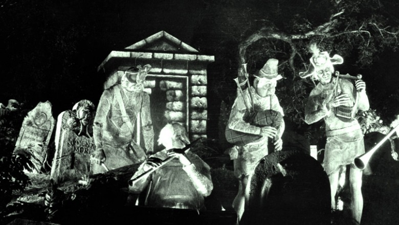 black and white photo of ghost players amidst tombstones from Disneyland's The Haunted Mansion