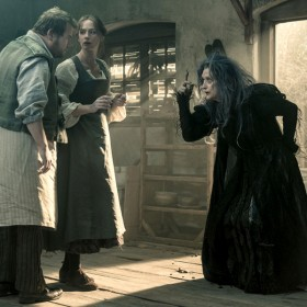 scene from feature Into the Woods with Meryl Streep as the witch, Emily Blunt as the Baker's Wife, and James Corden as the Baker