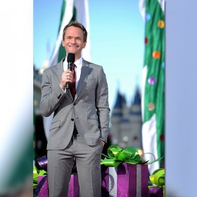 photo of Neil Patrick Harris in suit holding microphone
