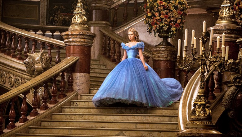 87dc0840 movie still of Cinderella in an elaborate blue dress descending grand  stairway