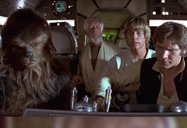 movie still from Star Wars Episode 4 showing Chewbacca, Obi-Wan Kenobi, Luke Skywalker, Han Solo, Millenium Falcon
