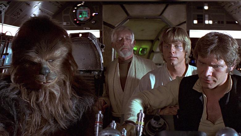 movie still from Star Wars Episode 4 showing Chewbacca, Obi-Wan Kenobi, Luke Skywalker, Han Solo, Millenium Falcon