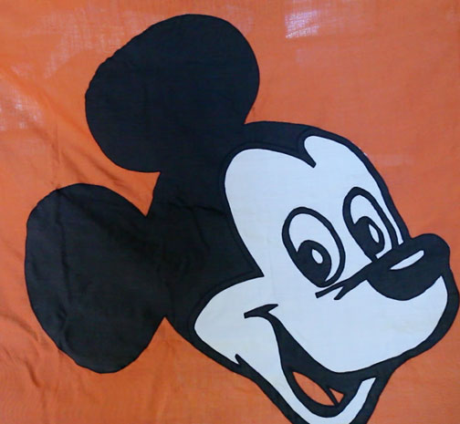 photo of orange, black and white Mickey Mouse flag