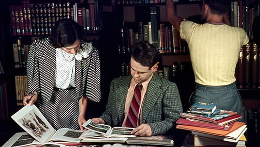 Animator Ward Kimball (center) is pictured at the Studio Library