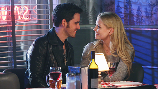 production still of actors COLIN O'DONOGHUE and JENNIFER MORRISON seated close together in a romantic restaurant at night