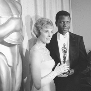 Julie Andrews (seen here with presenter Sidney Poitier) moments after having received a Best Actress Oscar for her film debut in Walt Disney's Mary Poppins.