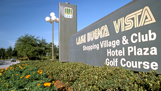 photo of sign at entrance with text Lake Buena Vista Shopping Village & Club Hotel Plaza Golf Course