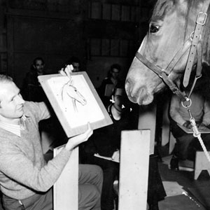 Studio art teacher Bernard Garbutt showing his drawing to a horse.