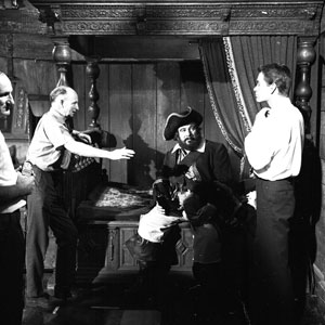 """Walt Disney's premier live-action director Robert Stevenson on the Blackbeard's Ghost set with Peter Ustinov and Dean Jones. """"I really wasn't sure what to expect from Peter,"""" said Robert.  """"He is, after all, a director, too. But he disarmed me with his simple wholehearted co-operation.   And he figured that the best way he could help was to leave the directing to me unless I asked for his opinion. I should think that, being a director, he understood full well the problems of direction and gave his full support as he would have liked me to give mine had out positions been reversed."""""""