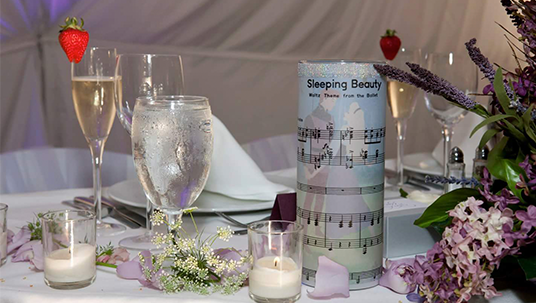 Disney Fan Wedding candles using the sheet music from Sleeping Beauty
