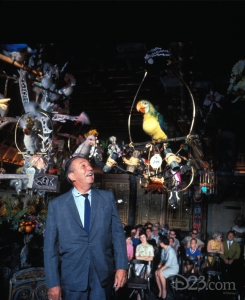 photo of Walt talking to Jose the Parrot in enchanted tiki room as seated guests watch from background