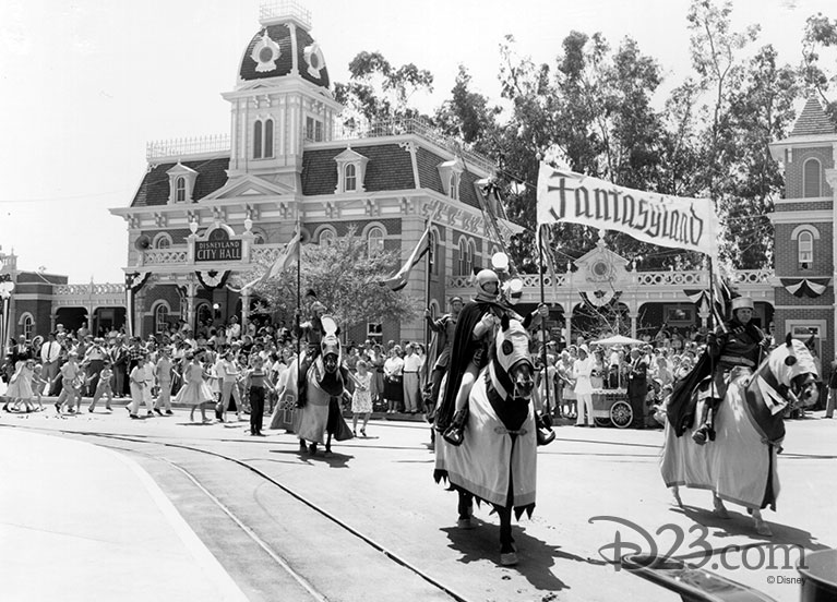 Men dressed as knights leading the Fantasyland portion of the Opening Day parade down Main Street U.S.A.