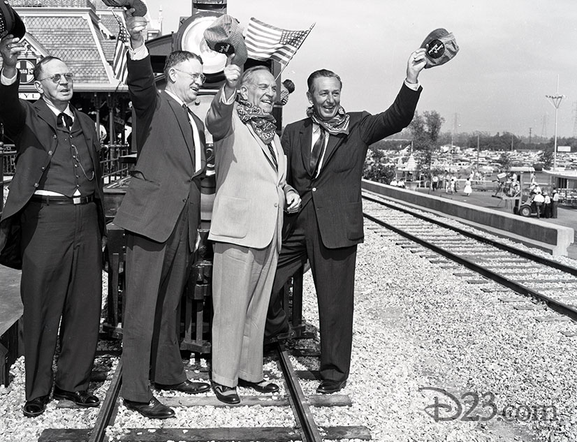 Walt Disney standing with Fred Gurley, Goodwin J. Knight in front of the E.P. Ripley train