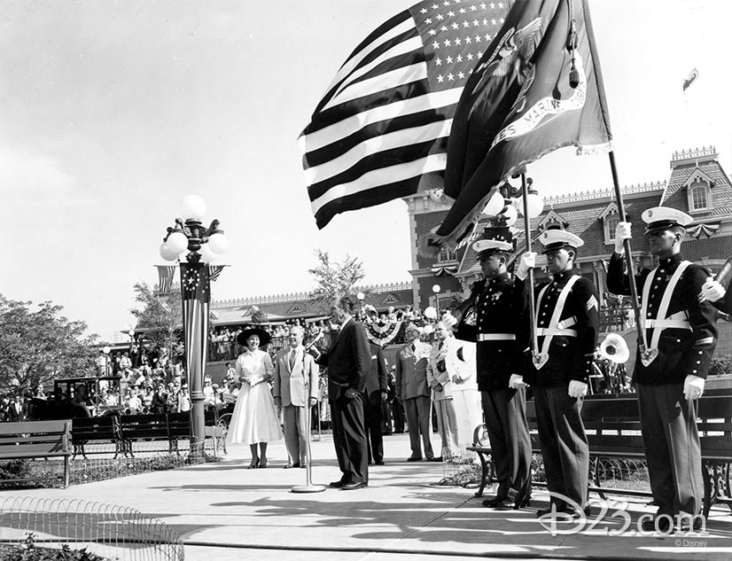 Walt Disney giving a speech in front of the Opening Day crowd