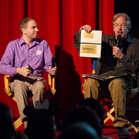 Disney Legend Tony Baxter showing a golden ticket from Disneyland U.S.A. Opening Day