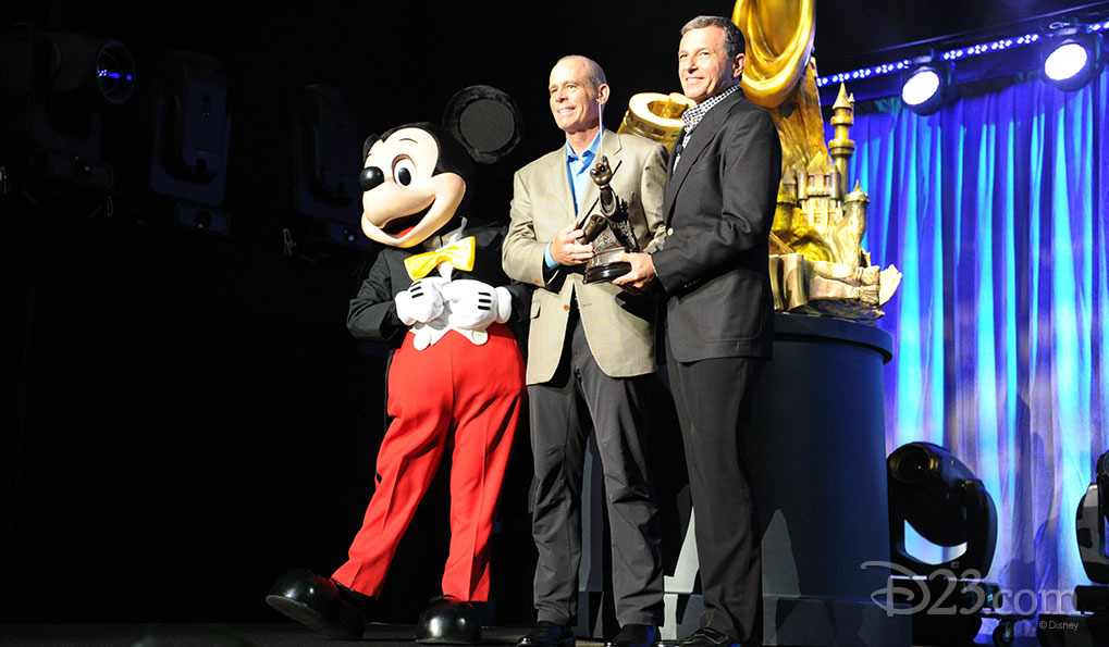 Mickey Mouse and Collin Campbell receiving a Disney Legend Award from Bob Iger